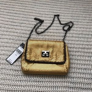 BCBG Gold clutch brand new with the tag